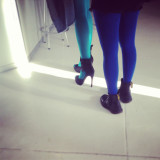 Teal tights with high heels vs blue tights with Doc Marten boots