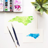 One large and one small painting of the state of North Carolina, USA. || Order your custom-painted original state and country art at www.mariorr.com