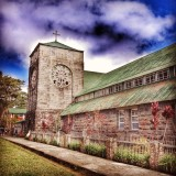 side view shot of the rustic, old town church of Sagada, taken on a beautiful day with blue skies..
