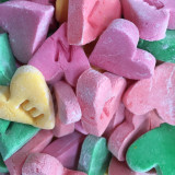 Home-made multicolored candy hearts.