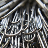 Full frame macro photograph of silver paper clips.