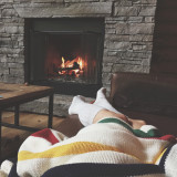 Cozy up by the fire. Cabin Socks and blanket.