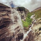 Waterfalls on Grossglockner glacier. Amazing sight with waterfalls everywhere on the slopes of Austrian alps.
