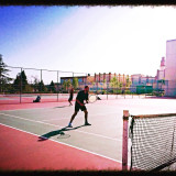 Tennis doubles under the glaring sun