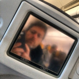 Reflection in the airplane seat monitor