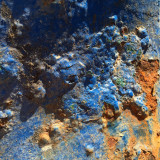 Details of rusty metal and blue paint.