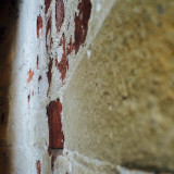 This is a picture of the wall inside the twin lighthouses. The paint is peeling leaving the original brick exposed.