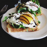 Egg and arugula on toast with balsamic vinegar