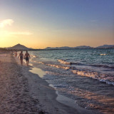 Couple walking along the beach at sunset in Majorca, Spain