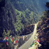 suspension bridge, buddha prayer flags, on my way to Mt. Everest.
