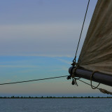Sailing on a old Dutch boat with a great sunset and Dutch horizon