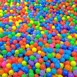 play pen full of colorful balls.