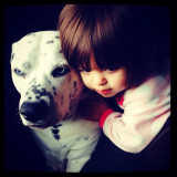 Portrait of my daughter and my dog, Sanford. Sharing a moment looking out the window together :)