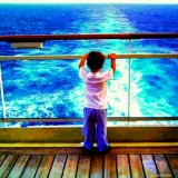 The World is his Oyster - Cruising somewhere in the Caribbean - REFLECTING with WONDER from his VANTAGE POINT...