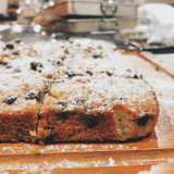 Chocolate chip and walnut blondies dusted lightly with icing sugar