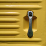 Door handle of yellow vintage Citroen van.