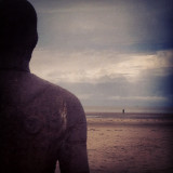 Sefton Beach in Merseyside has 100 sculptures of figures, all facing out to see. It's a stunning & atmospheric piece of work by Antony Gormley.