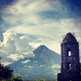 Majestic Mayon Volcano, perfect cone found in Legaspi City Albay Bicol Phils.Beside is the bellfry of the Cagsawa church,commonly called Cagsawa Ruins destroyed when the volcano erupted in the year 1814.