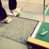 A lady plays golf