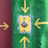 Colorful doorbell with four arrows