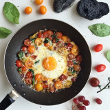 Sautéed assorted cherry tomatoes, grana padano cheese, basil and fried egg! Perfect breakfast!