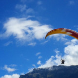 A man paragliding in the swiss alps