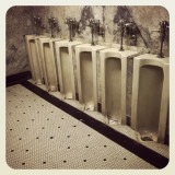 Urinals in the basement men's room at the Tower Theatre in downtown Los Angeles.