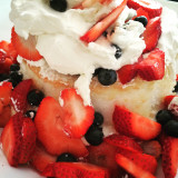Fast assembly short cake real whip cream real strawberries real blueberries but angel cake boom Bada bing ! You got cake!