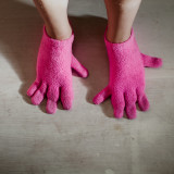 Wearing pink gloves on her feet.