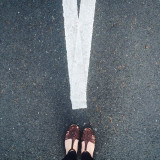 Feet and road