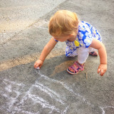 Girl drawing with chalk
