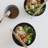 Vietnamese noodle bowl with spring rolls