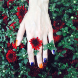 Beautiful female hand with flowers