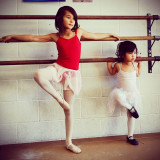 Sisters in ballet class