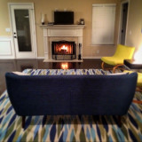 Retro mid century modern living room with fire