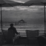 Having a glass of wine and watching the storm roll in. I like the mood in this photo. There are opposite attractions happening on multiple levels. Hope you enjoy it too.