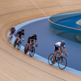 Cycling round the Olympic Park velodrome, London.