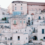 Matera is the only place in the world where people can boast to be still living in the same houses of their ancestors of 9,000 years ago .