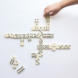 Playing dominos on a white background.