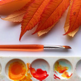 Bright orange leaves and paint