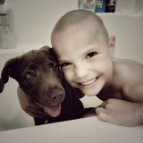 Elia is Ready to Take London Rose a Bath. A Little Boy's Best Friend! All Smiles...