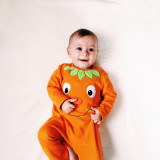 baby in the halloween costume orange pumpkin