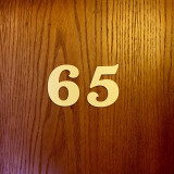 Number Sixty-five. Hotel room