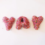 Donuts with sprinkles spelling YAY
