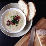 Hearty potato soup topped with bacon, and served with crusty bread
