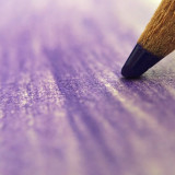Coloring with a purple colored pencil