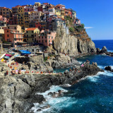 No beach? No problem! Locals jumps off the rocks in Manarola