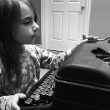 Our eldest Granddaughter testing out the Royal. I didn't tell her I learnt to type on one of these. I still remember the pain when your finger slipped through the keys!!