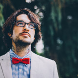 Man wearing bow tie & glasses