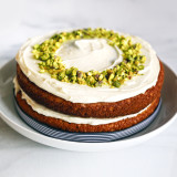 Carrot cake with cream cheese icing and crushed pistachios